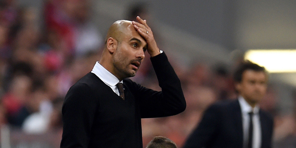 Bayern Munich's Spanish head coach Pep Guardiola reacts during the UEFA Champions League football match second leg semi final FC Bayern Munich vs FC Barcelona in Munich on May 12, 2015.  AFP PHOTO / PATRIK STOLLARZ