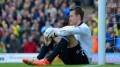 NORWICH, ENGLAND - APRIL 20: A dejected Simon Mignolet of Liverpool sits on the pitch after conceding a second goal during the Barclays Premier League match between Norwich City and Liverpool at Carrow Road on April 20, 2014 in Norwich, England.  (Photo by Michael Regan/Getty Images)