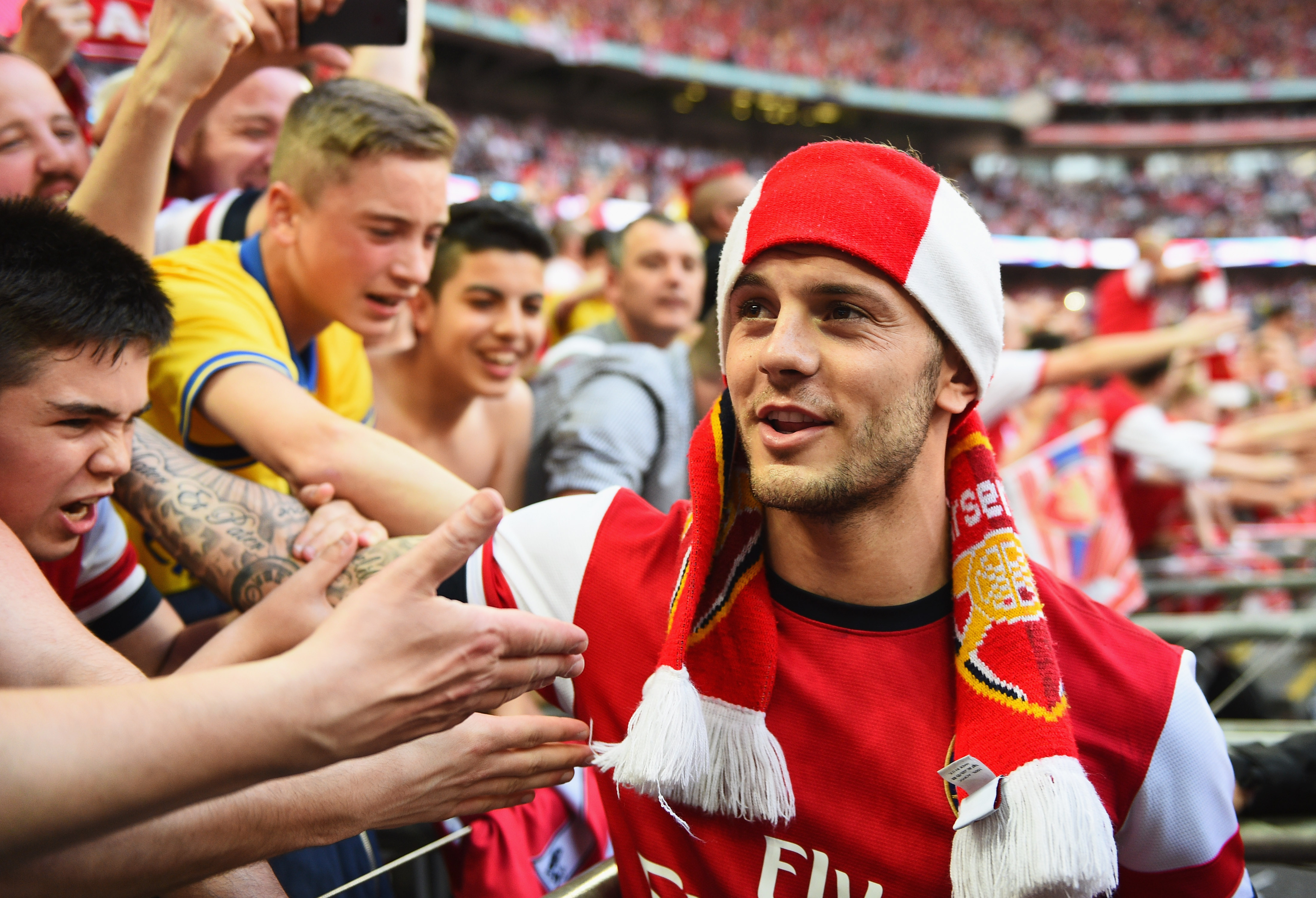 LONDON, ENGLAND - MAY 17:  Jack Wilshere of Arsenal celebrates victory with fans after the FA Cup with Budweiser Final match between Arsenal and Hull City at Wembley Stadium on May 17, 2014 in London, England.  (Photo by Shaun Botterill/Getty Images)