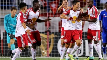 HARRISON, NJ - JULY 22:  Sean Davis #27 of New York Red Bulls is congratulated by teammates after he scored in the second half against Chelsea during the International Champions Cup at Red Bull Arena on July 22, 2015 in Harrison, New Jersey.The New York Red Bulls defeated Chelsea 4-2.  (Photo by Elsa/Getty Images)