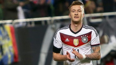 epa04679019 Germany's Marco Reus reacts after scoring the 1-0 lead during the international friendly soccer match between Germany and Australia at Fritz Walter Stadium in Kaiserslautern, Germany, 25 March 2015.  EPA/FREDRIK VON ERICHSEN
